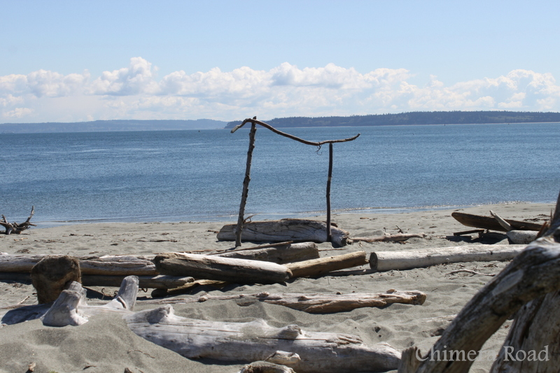 Someone built this arch on the beach at Fort Worden. You can actually find lots of these type of things - we found a zen-rock structure on another day. I was fascinated with this loved how they'd found just the right sticks for it.
