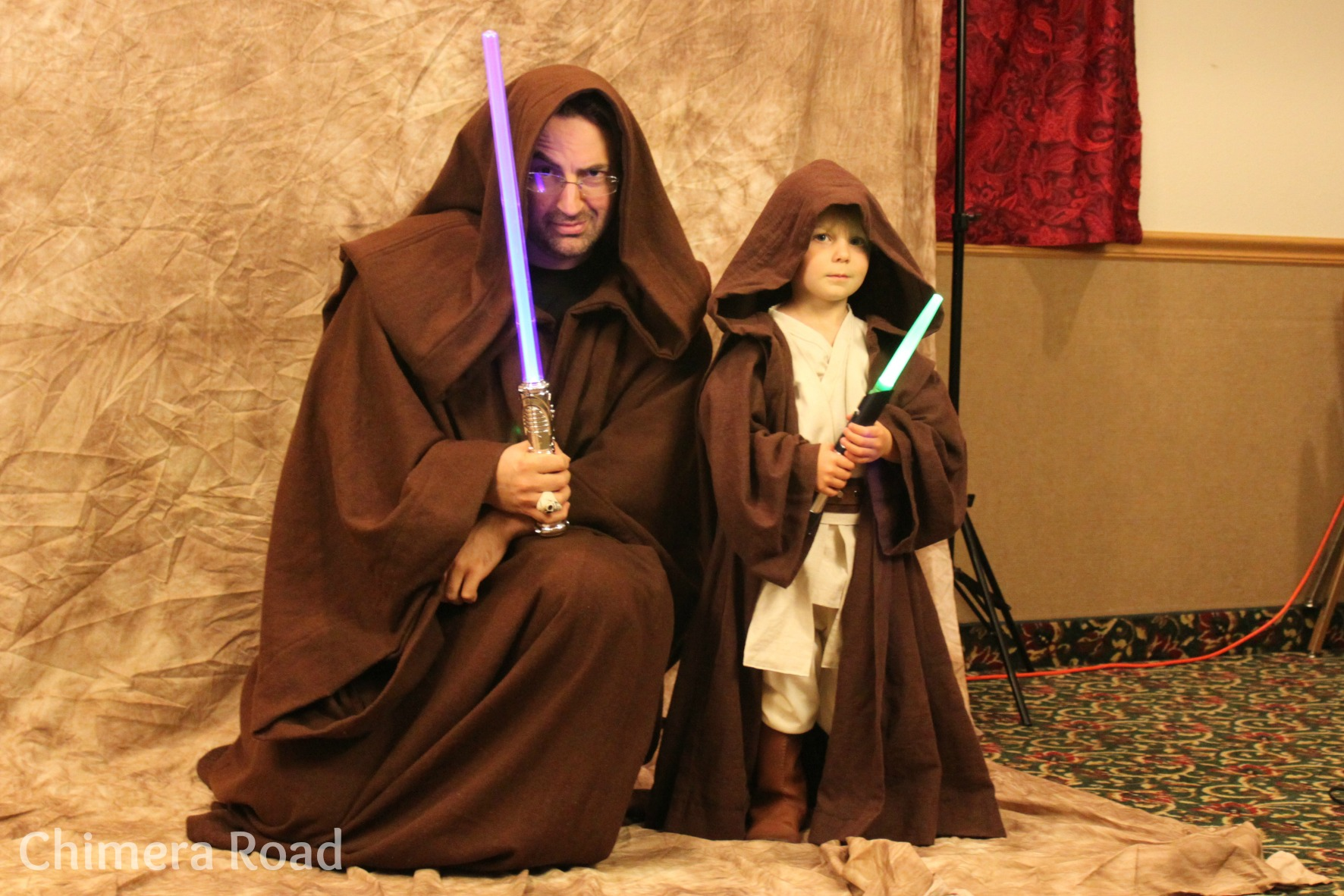 Munchkin posing with Jim Butcher, author extraordinaire, Miscon Guest of Honor 2013, and wearer of an adult sized Jedi cloak I made. :D